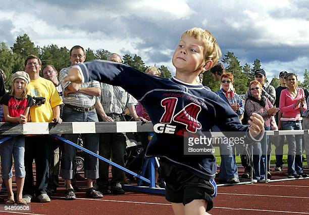 A young Finn takes his turn throwing in the Junior class during the sixth annual MobilePhone Throwing World championships in Savonlinna Finland on...