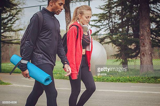 Young fit couple walking and relaxing after strenuous workout