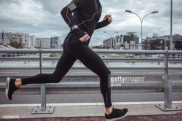Young fit man running and listening to music