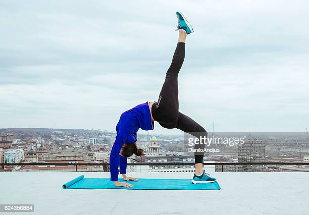 young fit woman working out on the rooftop