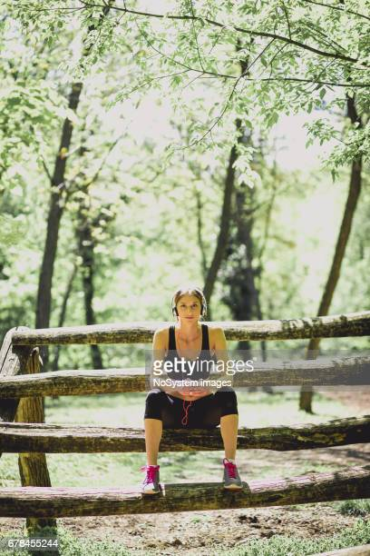 Young fitness girl relaxing and preparing for outdoor workout.