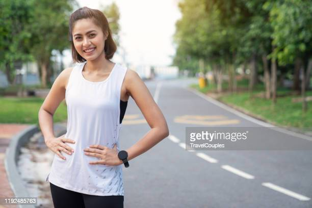 young fitness sports women runner running in the park. healthy fitness woman jogging outdoors. sport and health concept - southeast asia stock pictures, royalty-free photos & images