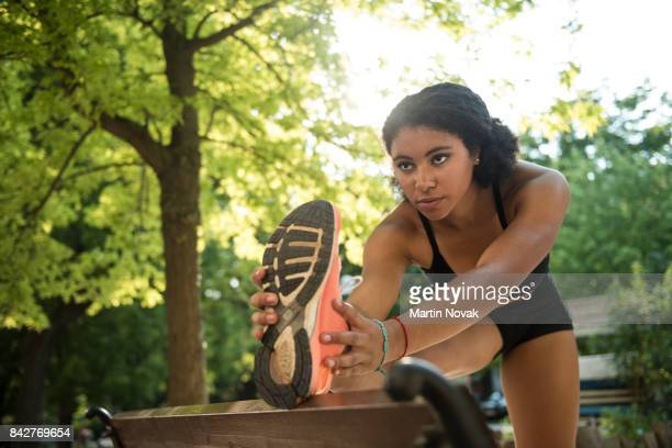 Young fitness woman doing stretching exercise