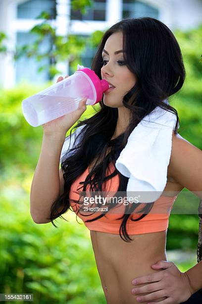 Young Fitness Woman Drinking from a Water Bottle