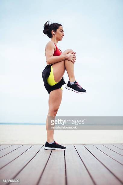 Young fitness woman preparing for training