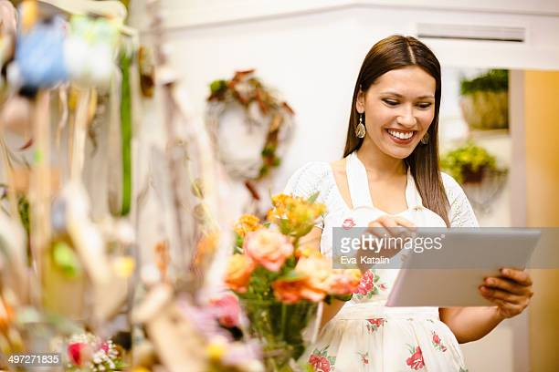 Young florist working in her shop
