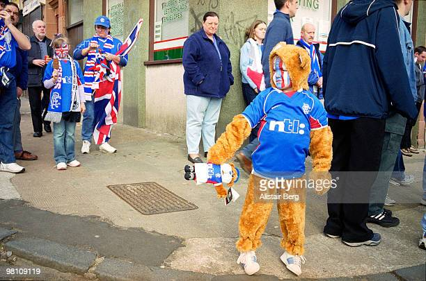 young football fan in fancy dress costume - bear suit stock pictures, royalty-free photos & images