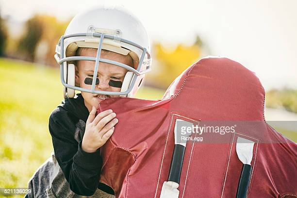young football player - tackling stock pictures, royalty-free photos & images