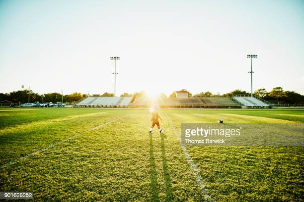 young football player walking on football field after practice - texas independence day stock pictures, royalty-free photos & images