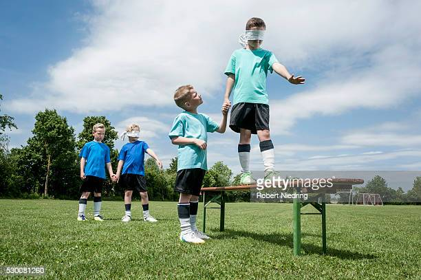 Young football players learning trust courage