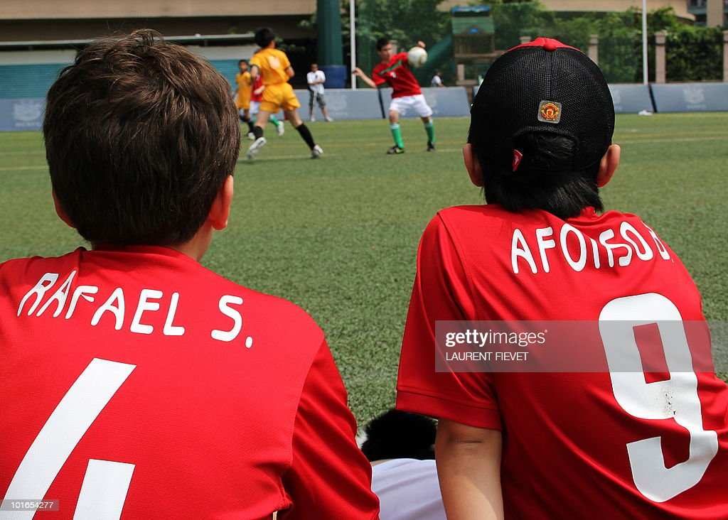 Young football players representing Portugal watch the Mini World Cup 2010 in Hong Kong on June 6, 2010. The South Africa 2010 World Cup will start on June 11.