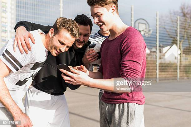 Young football players with smartphone