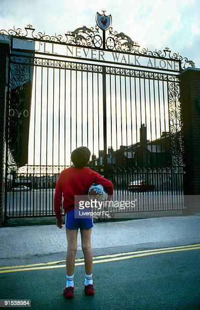 A young footballer looks up at the Shankly Gates and dreams of pulling on the red shirt for his club