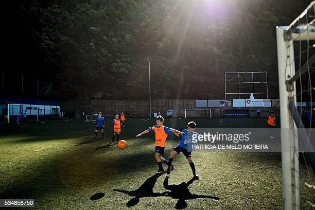 TOPSHOT Young footballer play during a match at CF Andorinha football club in Funchal Madeira island on April 30 2016 Portuguese football star...