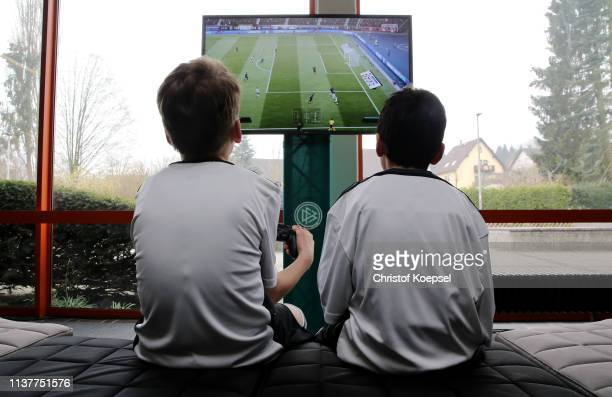 Young footballer play Playstation during the German Futsal Championship of A, B And C Juniors at Sporthalle West on March 23, 2019 in Gevelsberg,...