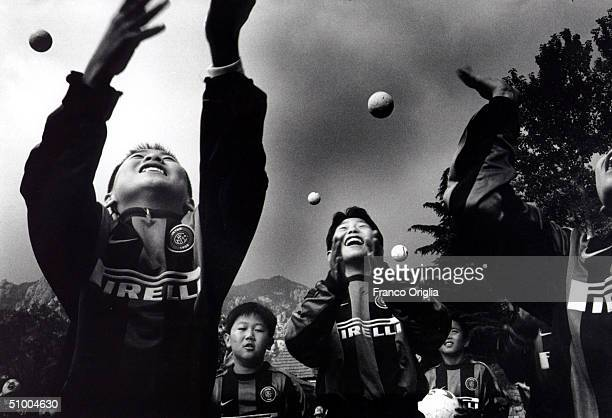 Young footballers involved with Inter Campus Project juggle with fotoballs March 28 2002 in Qingdao China Inter Campus is a social program enacted by...