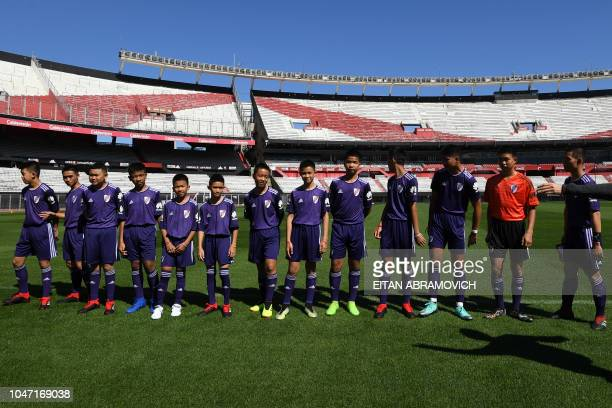 Young footballers of Thai team Wild Boars who were rescued from the Tham Luang cave in Thailand past July pose for a picture at Monumental stadium in...