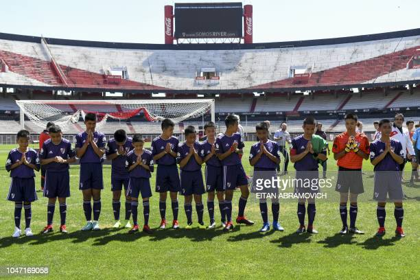 Young footballers of Thai team Wild Boars who were rescued from the Tham Luang cave in Thailand past July acknowledge after playing a football match...