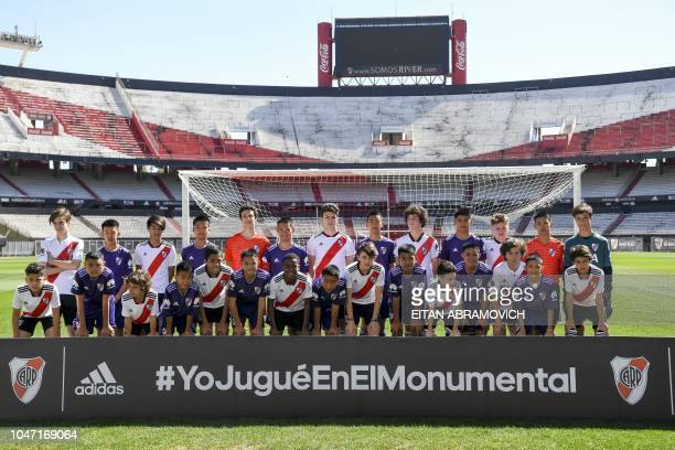 Young footballers of Thai team Wild Boars who were rescued from the Tham Luang cave in Thailand past July pose with River Plate Youth Team before a...