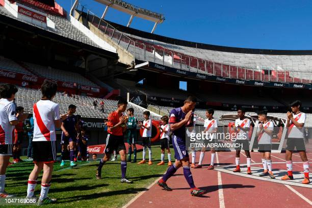 Young footballers of Thai team Wild Boars who were rescued from the Tham Luang cave in Thailand past July enter Monumental stadium in Buenos Aires in...