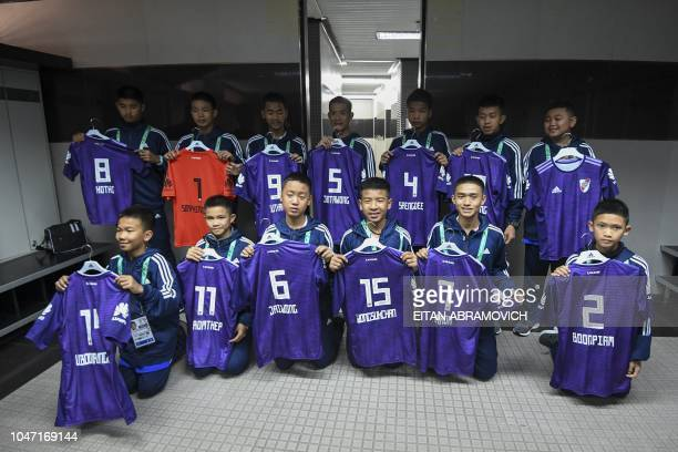 Young footballers of Thai team Wild Boars who were rescued from the Tham Luang cave in Thailand past July pose at the changing room of River Plate's...