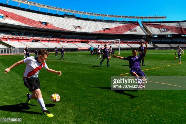 Young footballers of Thai team Wild Boars who were rescued from the Tham Luang cave in Thailand past July play a football match against River Plate...