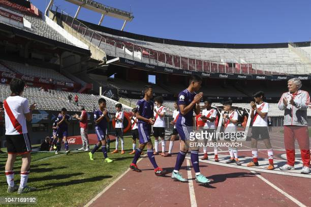Young footballers of Thai team Wild Boars who were rescued from the Tham Luang cave in Thailand past July enter River Plate's Monumental stadium in...