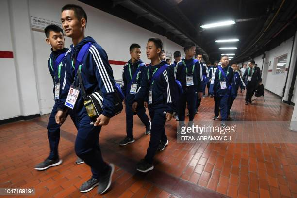Young footballers of Thai team Wild Boars who were rescued from the Tham Luang cave in Thailand past July tour River Plate's Monumental stadium in...