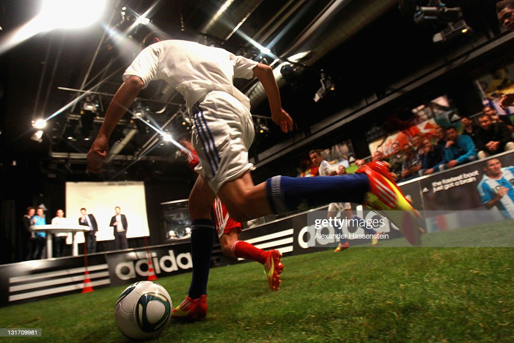 Young footballers play a demonstration match with the new adizero boots during the adidas adizero F50 miCoach launch event at Miller studio on November 7, 2011 in Zurich, Switzerland.