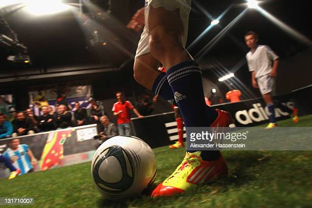 Young footballers play a demonstration match with the new adizero boots during the adidas adizero F50 miCoach launch event at Miller studio on...