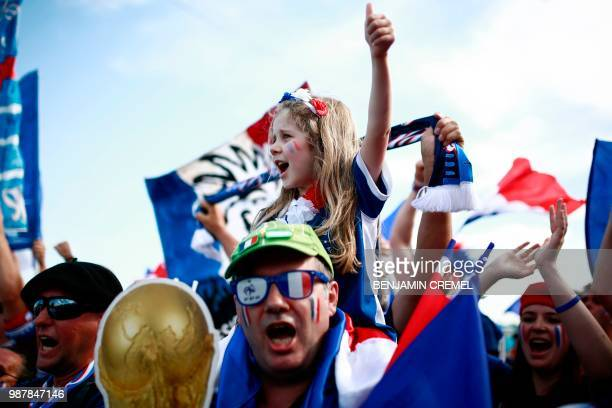 A young France fan cheers before the Russia 2018 World Cup round of 16 football match between France and Argentina at the Kazan Arena in Kazan on...