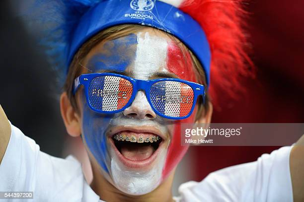 A young France supporter enjoys the atmosphere prior to the UEFA EURO 2016 quarter final match between France and Iceland at Stade de France on July...