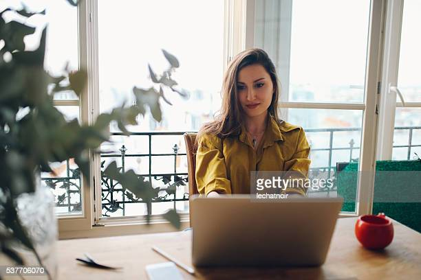 Young freelancer woman working in her Parisian apartment