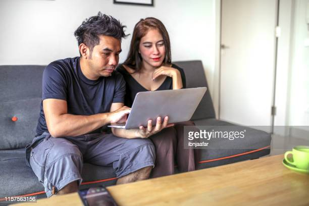 young freelancer working at home with partners - ibnjaafar stock photos and pictures