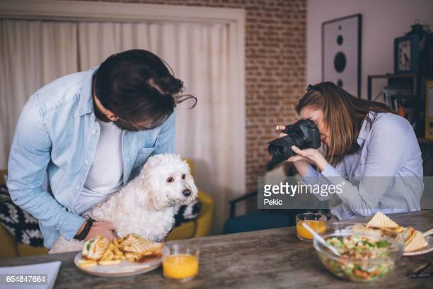 Young freelancers working and play with dog