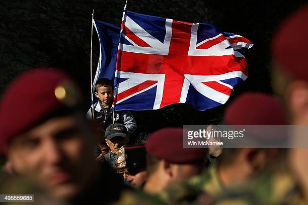 A young French boy waves British and French flags during a military parade marking the week of DDay June 4 2014 in Carentan France June 6th is the...