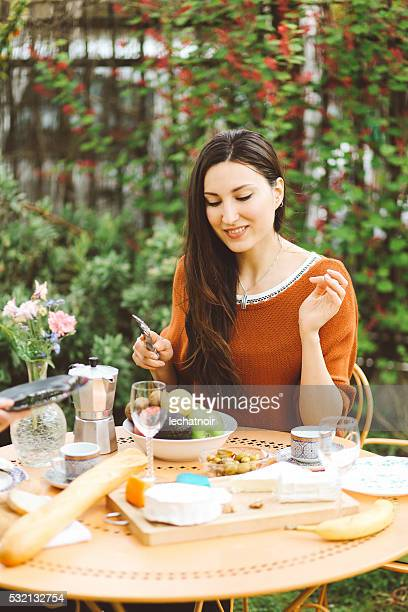 Young French girl eating in the garden home