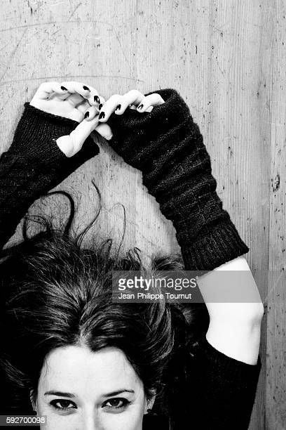 Young French woman laying on the floor and looking into the camera