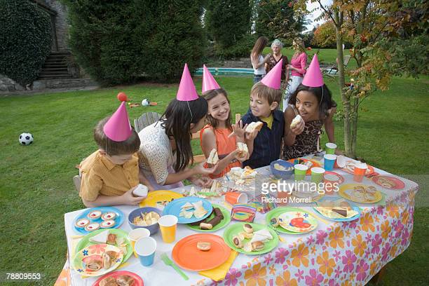 young friends at birthday party - happy birthday richard stock pictures, royalty-free photos & images