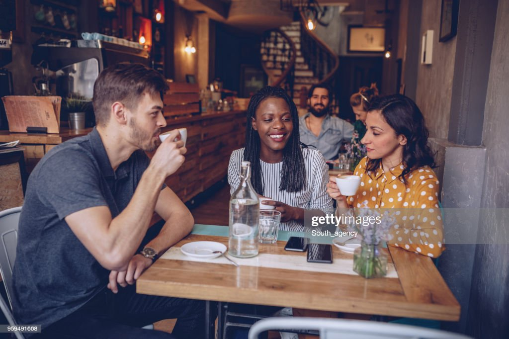 Young friends at coffee shop : Stock Photo