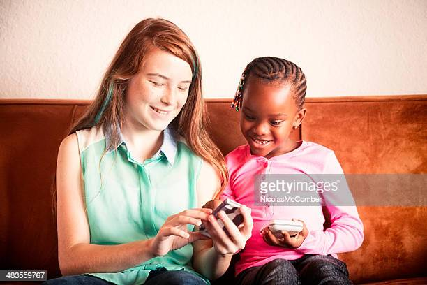 Young friends comparing mobile phones