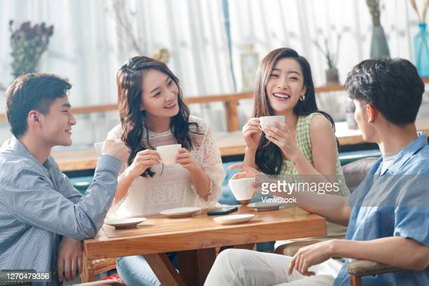 young friends drink coffee chat - coffee drink stock pictures, royalty-free photos & images