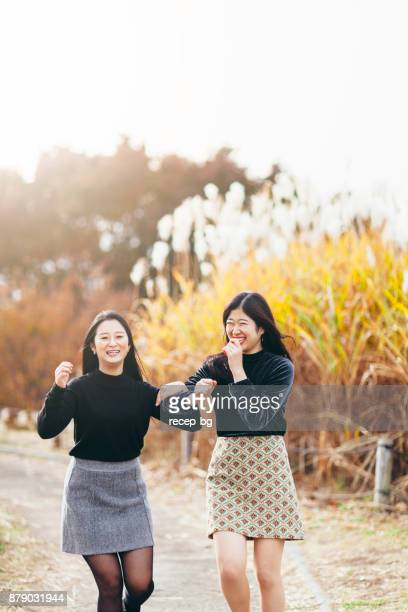 young friends enjoying in autumn - japanese short skirts stock pictures, royalty-free photos & images