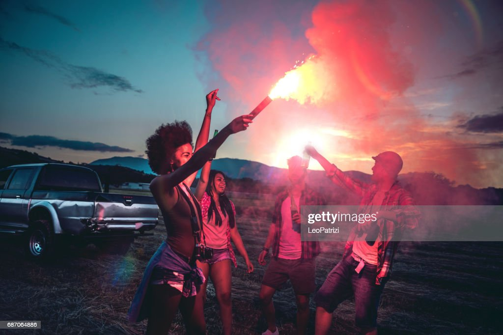Young friends enjoying the freedom on a Car Trip over a country offroad : Stock Photo