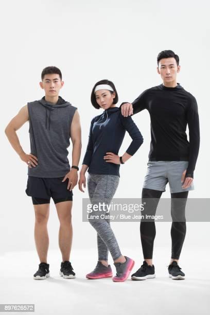 young friends exercising - ランニングショートパンツ ストックフォトと画像