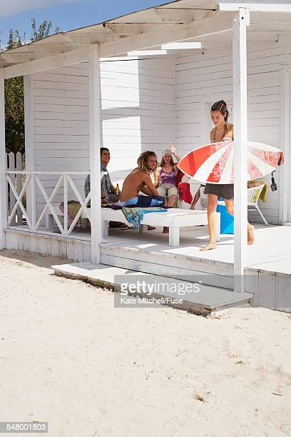 Young Friends Hanging Out at Beach Cabin