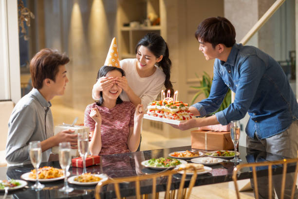 young friends having birthday party at home - best friend birthday cake stock pictures, royalty-free photos & images