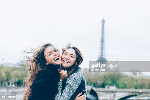 Young friends having fun in front of Eiffel tower