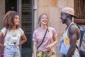 three multiethnic young friends having fun
