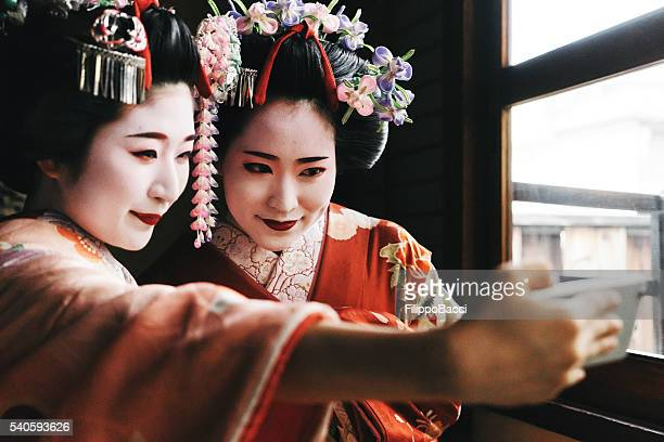 Young Friends In Traditional Japanese Clothing Having Selfie Together